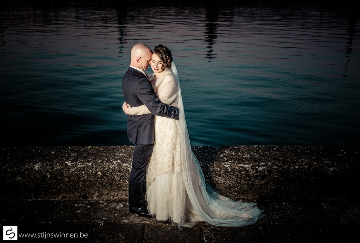 Couple embracing each other near the water